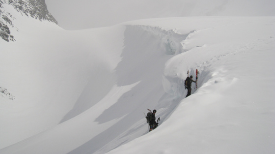 Backcountry skiers climb Selkirk Mountains, BC.