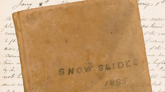 Colour photograph of cover of leather-bound notebook titled 'Snowslides 1885'.