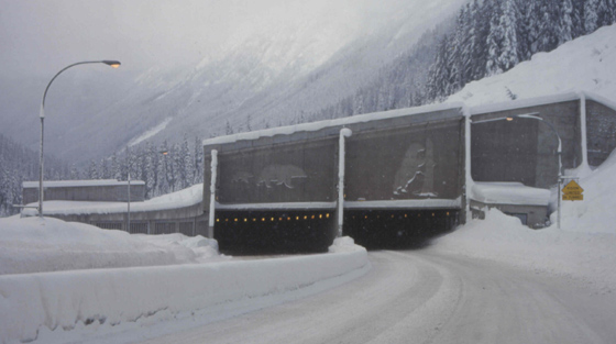 Colour photo of mountain pass snowshed in winter.
